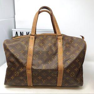 Louis Vuitton Sac souple 35 Monogram travel bag